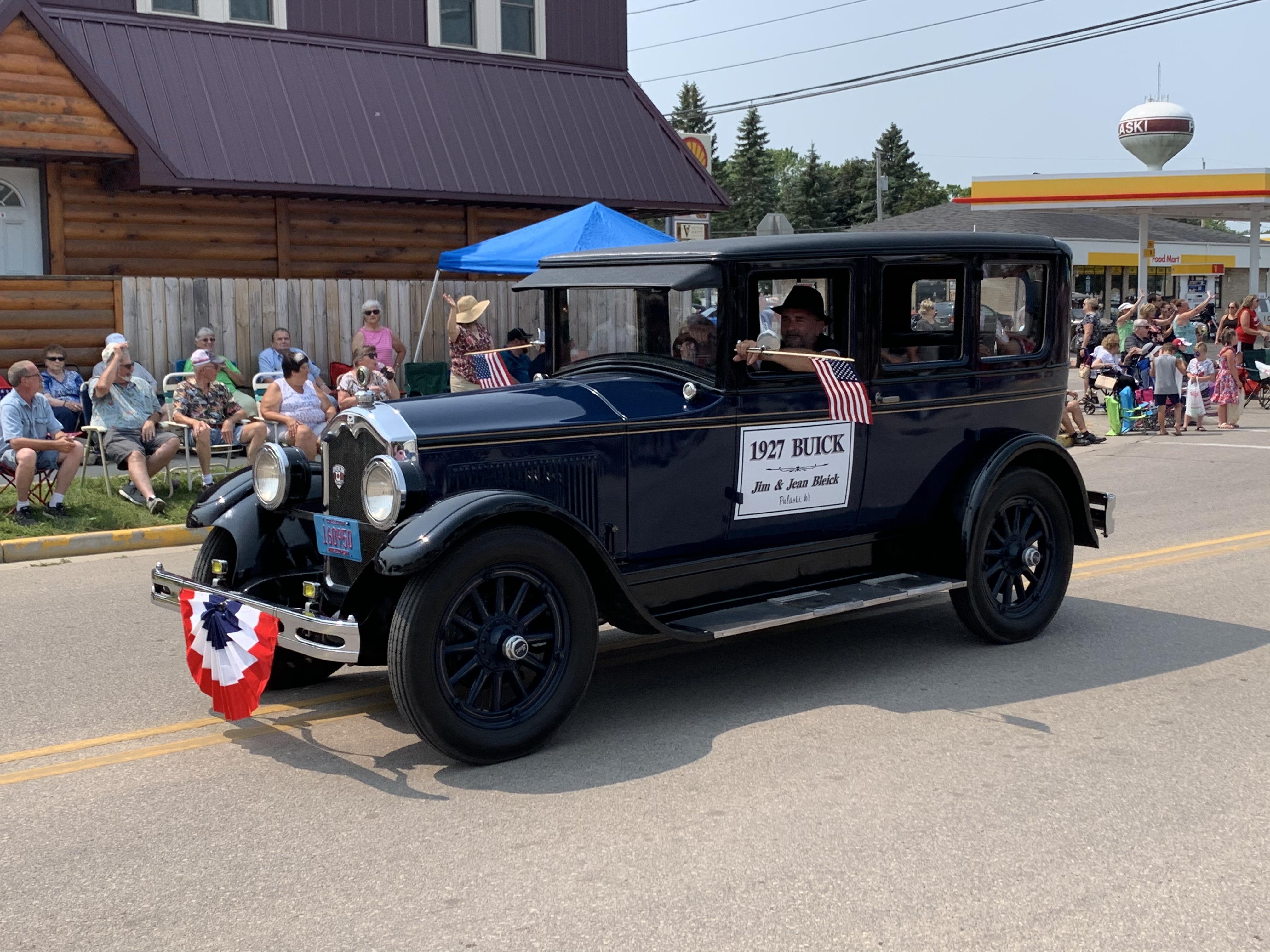 A 1927 Buick drives down Pulaski Street on July 18.Luke Reimer   NEW Media